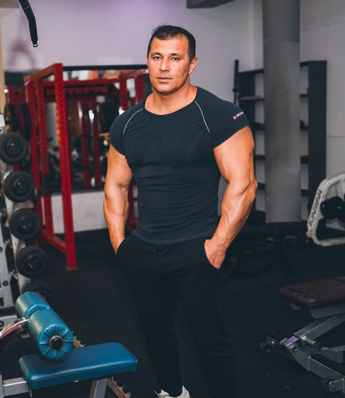 Man in Black Crew Neck T-shirt and Black Pants
