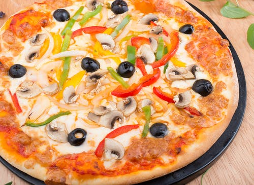 Pizza With Green and Red Bell Pepper on Top