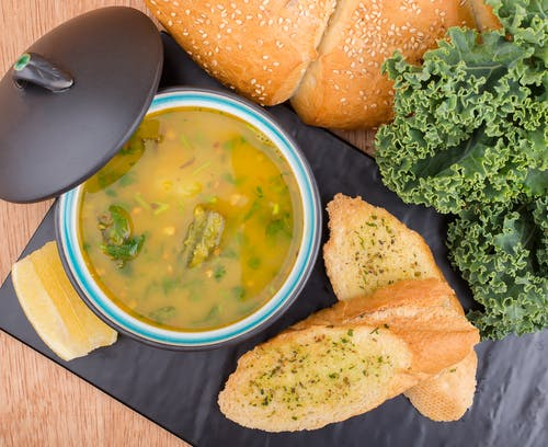 Bread and Soup on a Black Tray
