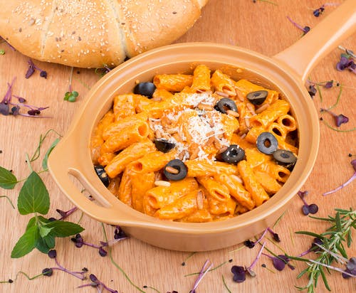 Pasta with Black Olives on Ceramic Bowl