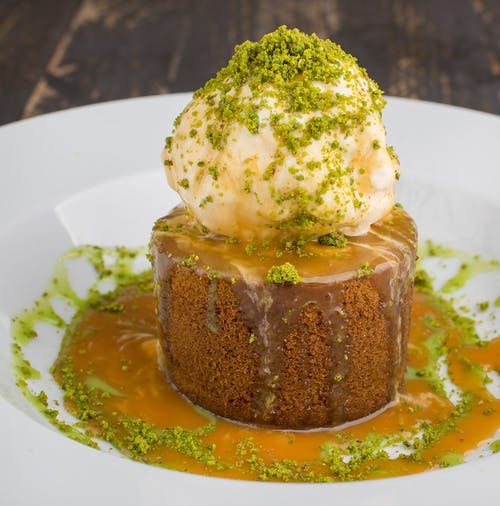 Brown Cake with Ice Cream on Top