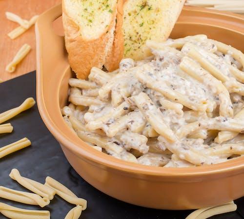 White Pasta on Brown Ceramic Bowl