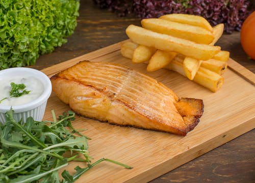 Salmon on Brown Wooden Chopping Board