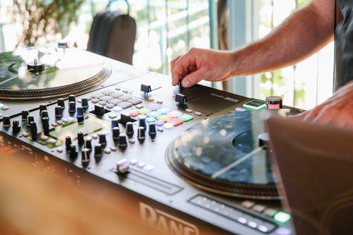 Person Playing with Black Dj Mixer