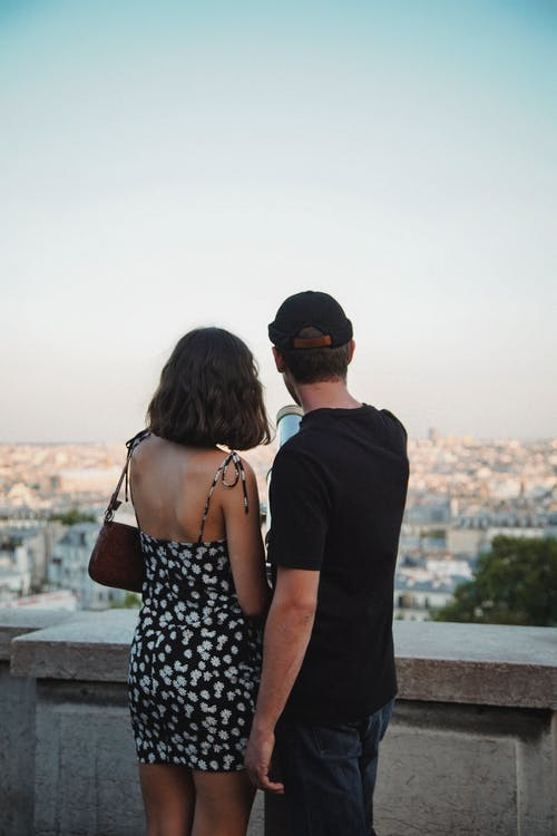 Man and Woman Looking at the View