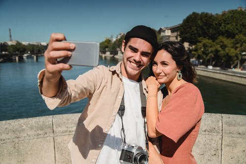 Man Taking a Selfie with a Woman
