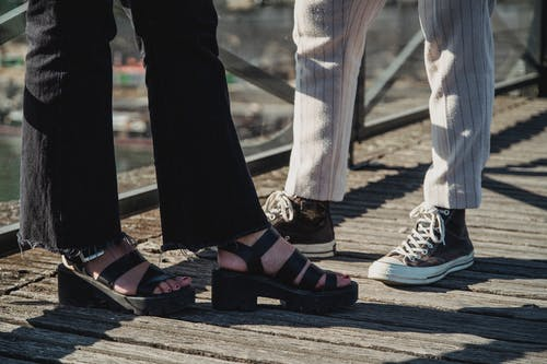 People Wearing Sneakers and Sandals