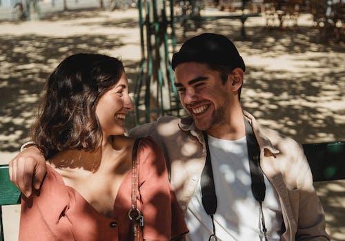 Man's Arm Around Woman's Shoulder