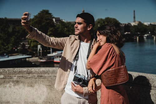 Man and Woman Taking Photos Together