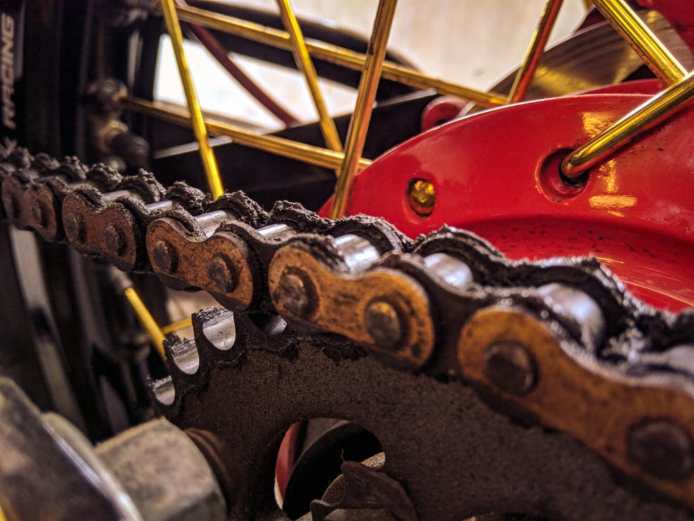 Closeup of bicycle transmission system with metal chain on hydraulic disk brake on wheel