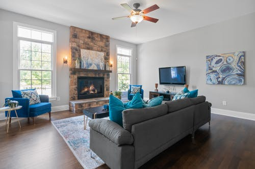 Blue Armchairs and Gray Sofa in a Living Room