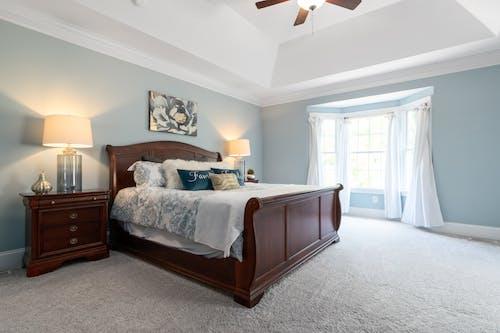 Brown Wooden Bed Frame in a Bedroom