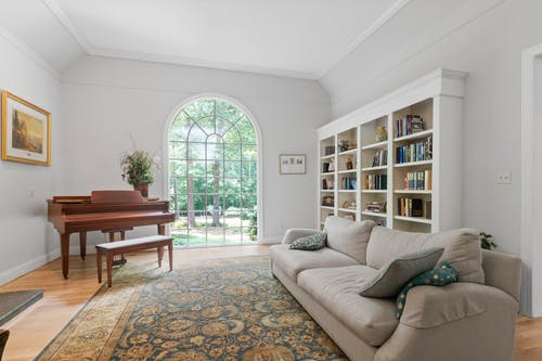 Gray Couch Near Brown Wooden Piano