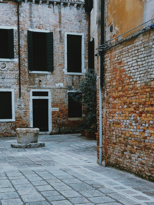 Old brick buildings on pavement street