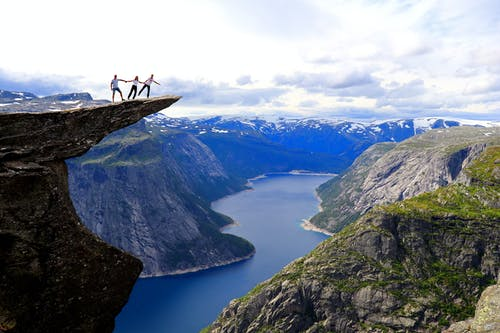 People Standing on a Cliff