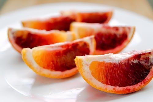 Sliced Orange Fruit on Ceramic Plate