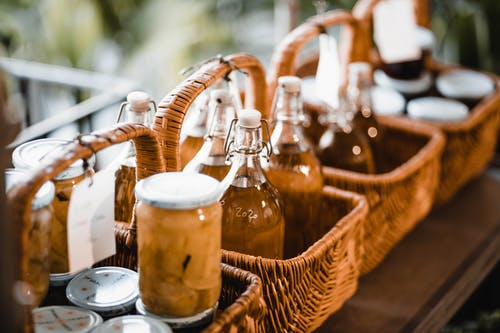 Bottles and Jars in Brown Woven Baskets