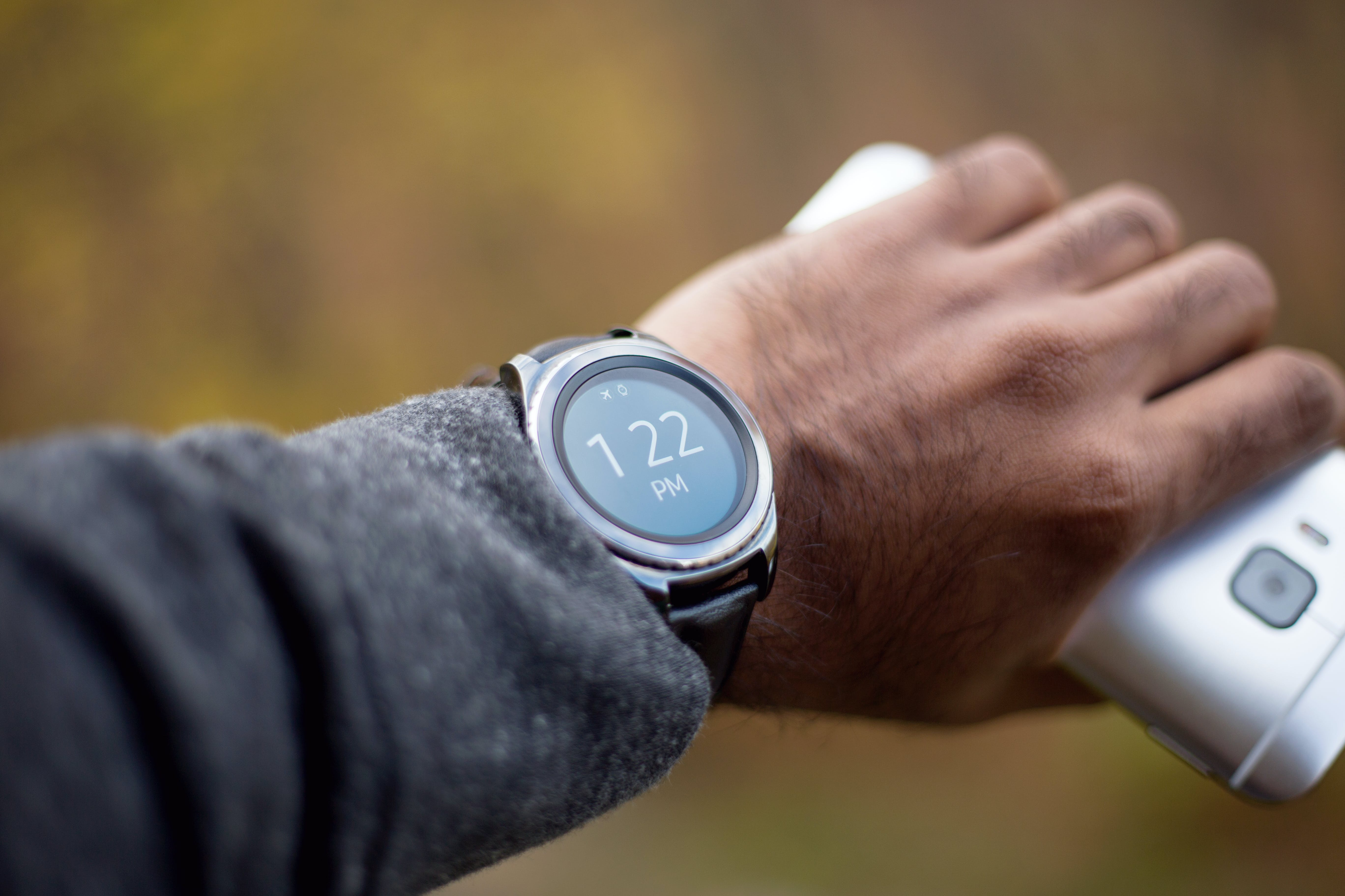 Silver-colored Smartwatch With Black Strap on Person's Wrist