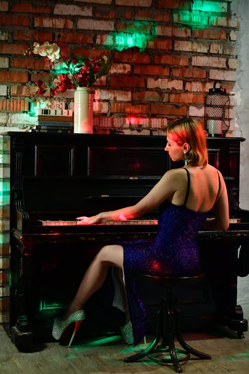 Graceful skilled woman playing piano