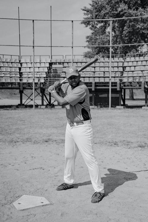 Black and White Photo of a Man Playing Baseball