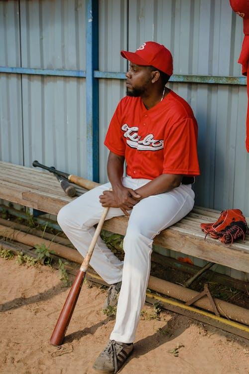 Baseball Player Sitting on a Bench