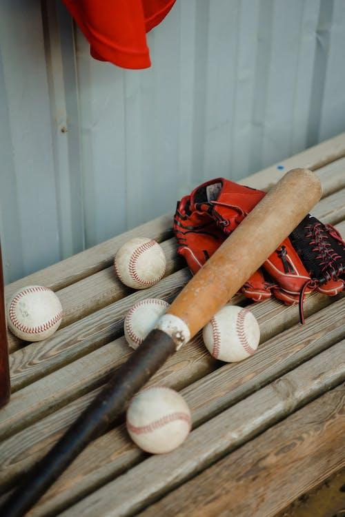 Baseball Bat and Balls on a Bench