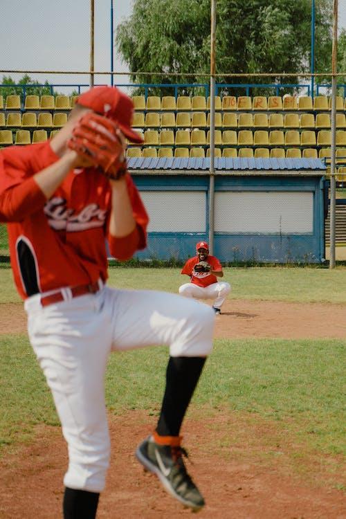 Man Pitching a Baseball