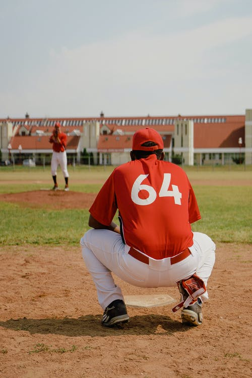 Catcher in Red Jersey Waiting for the Ball