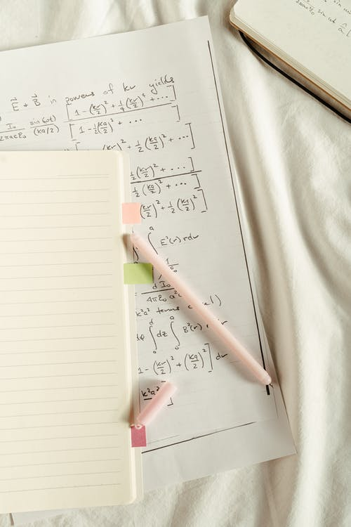 Pink Pen on White Ruled Paper