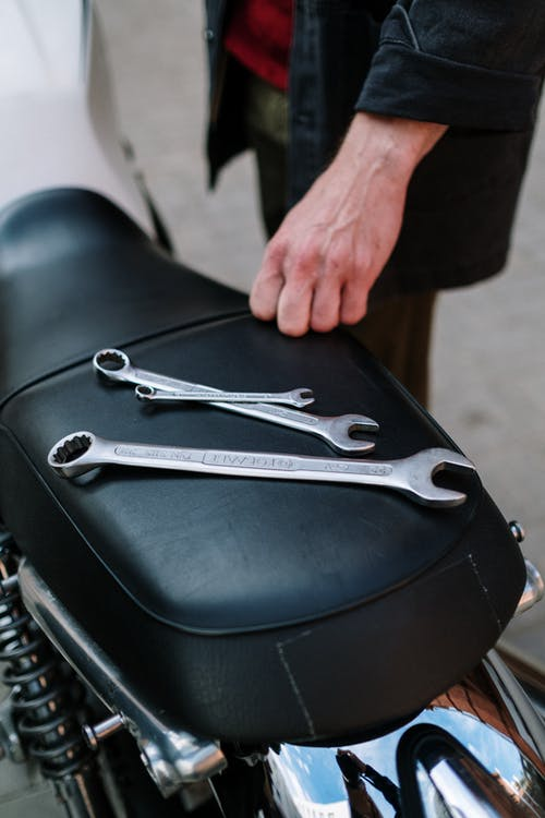 Metal Wrenches on Motorbike's Seat