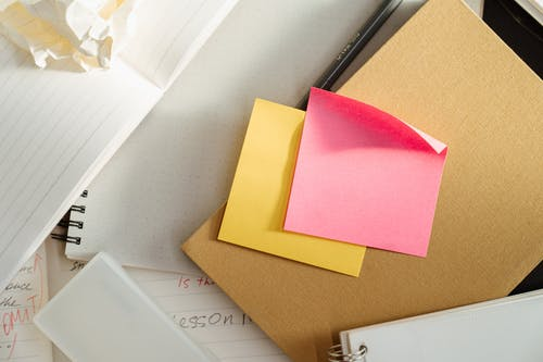 Pink Sticky Notes on White Table