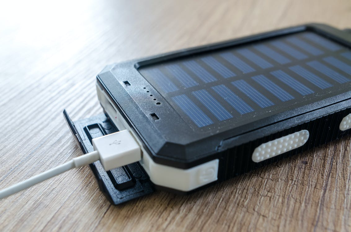 Black Solar Power Bank on Brown Surface