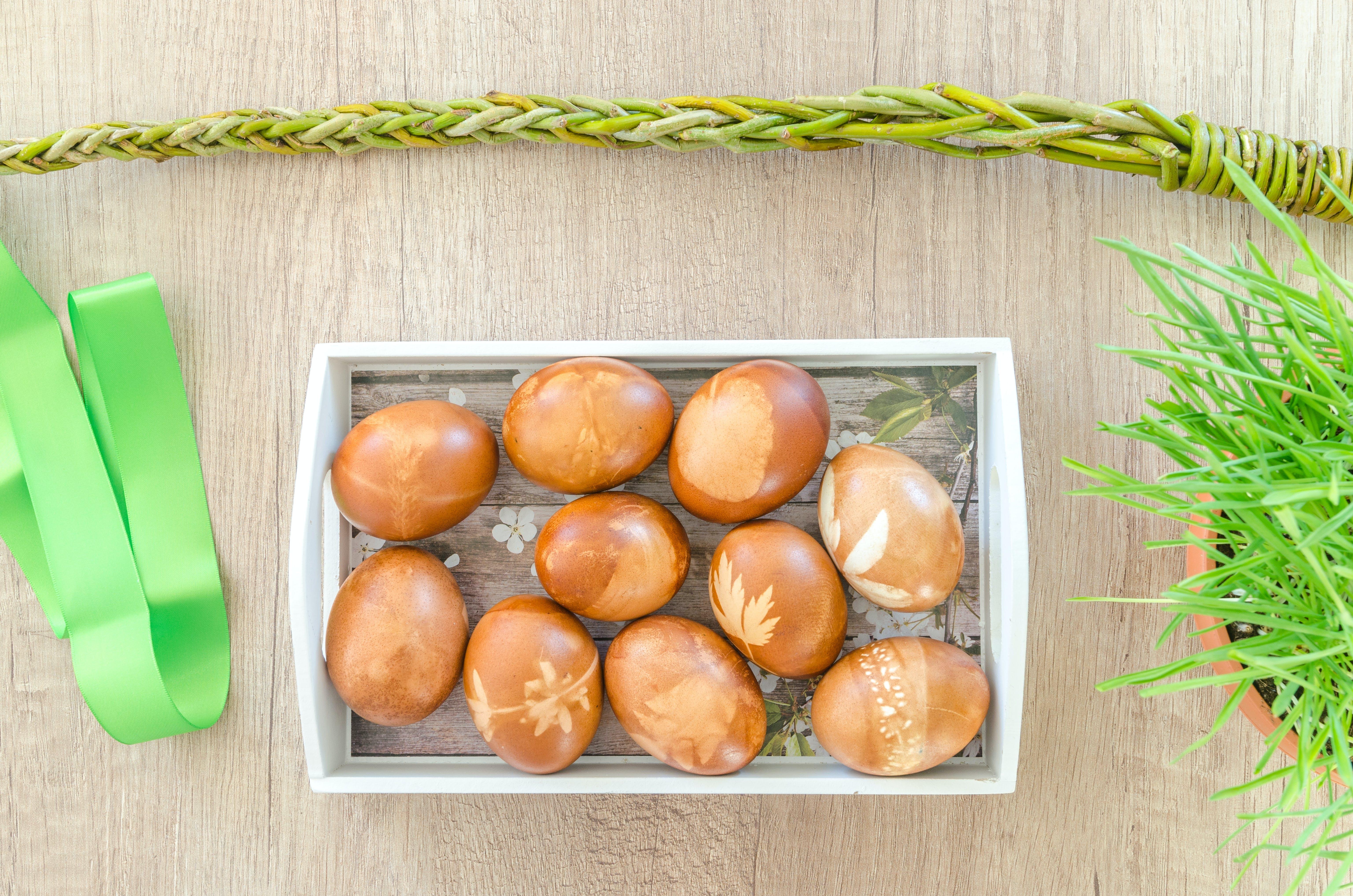 Egg on Top of White Wooden Basket