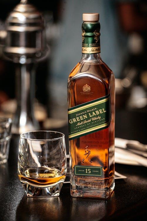 Jack Daniels Old No 7 Bottle Beside Clear Drinking Glass