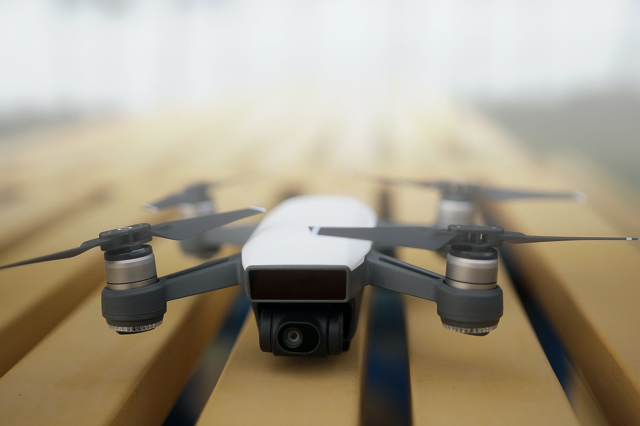 Shallow Focus Photography of White and Gray Quadcopter