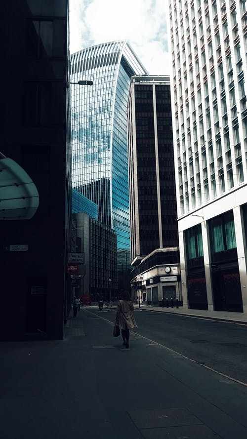 Exterior of contemporary facades of skyscrapers with glass and geometric walls on city street