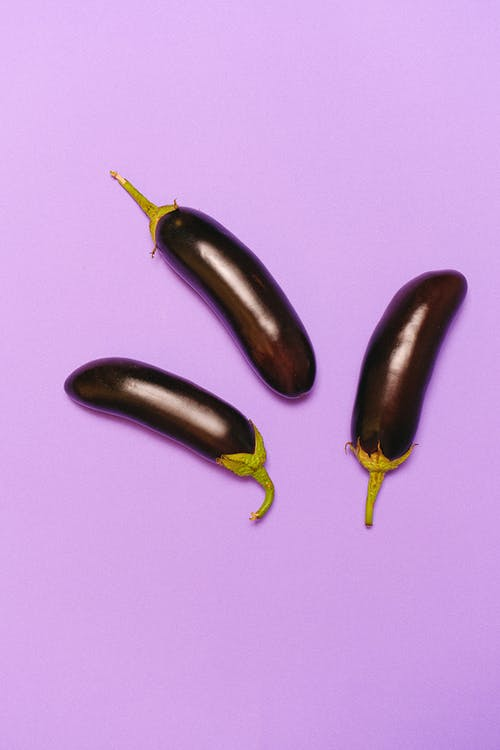 Eggplants on Light Purple Background