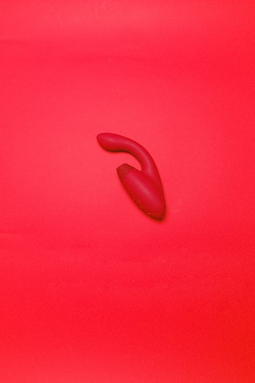 Sex Toy on a Red Background