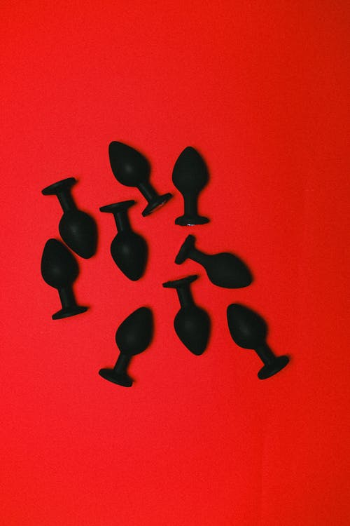 Sex Toys on a Red Background