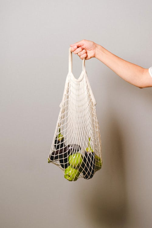 Bag With Green Apples and Eggplants