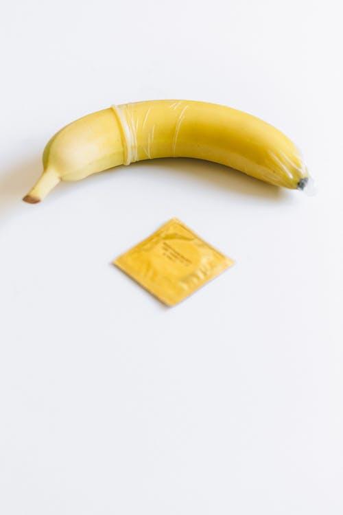 Condom Next to Yellow Banana