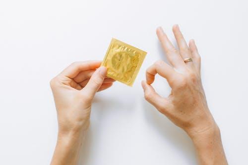 Person Holding Condom