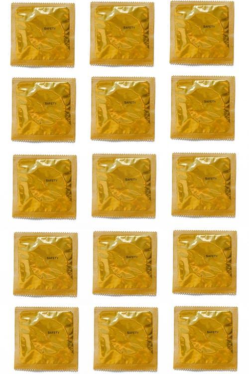 Yellow Condoms on White Background