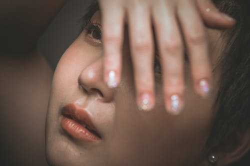 Crop sensual Asian woman with makeup and manicure