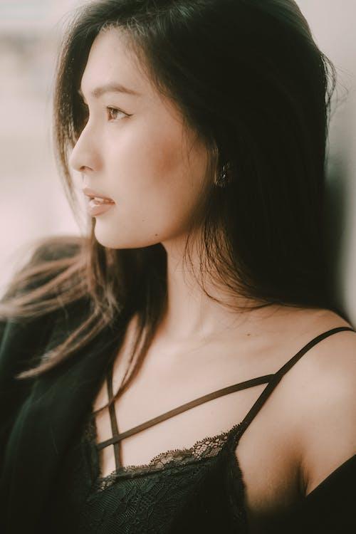 Crop sensual dreamy Asian model in black wear