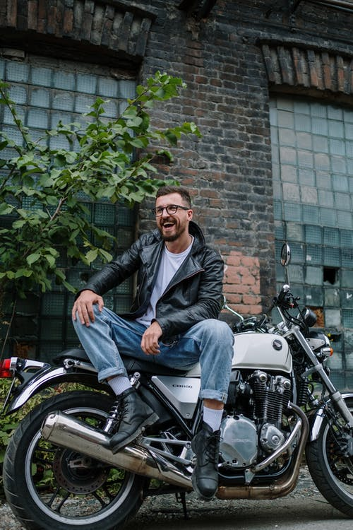 Man in Black Jacket Sitting on Motorcycle