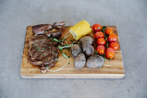 Grilled Meat Corn and Corn on Brown Wooden Chopping Board