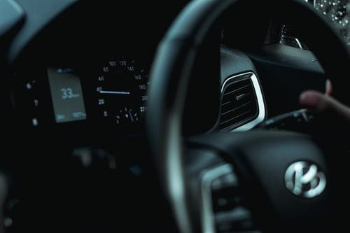 Black Car Steering Wheel in Close Up Photography