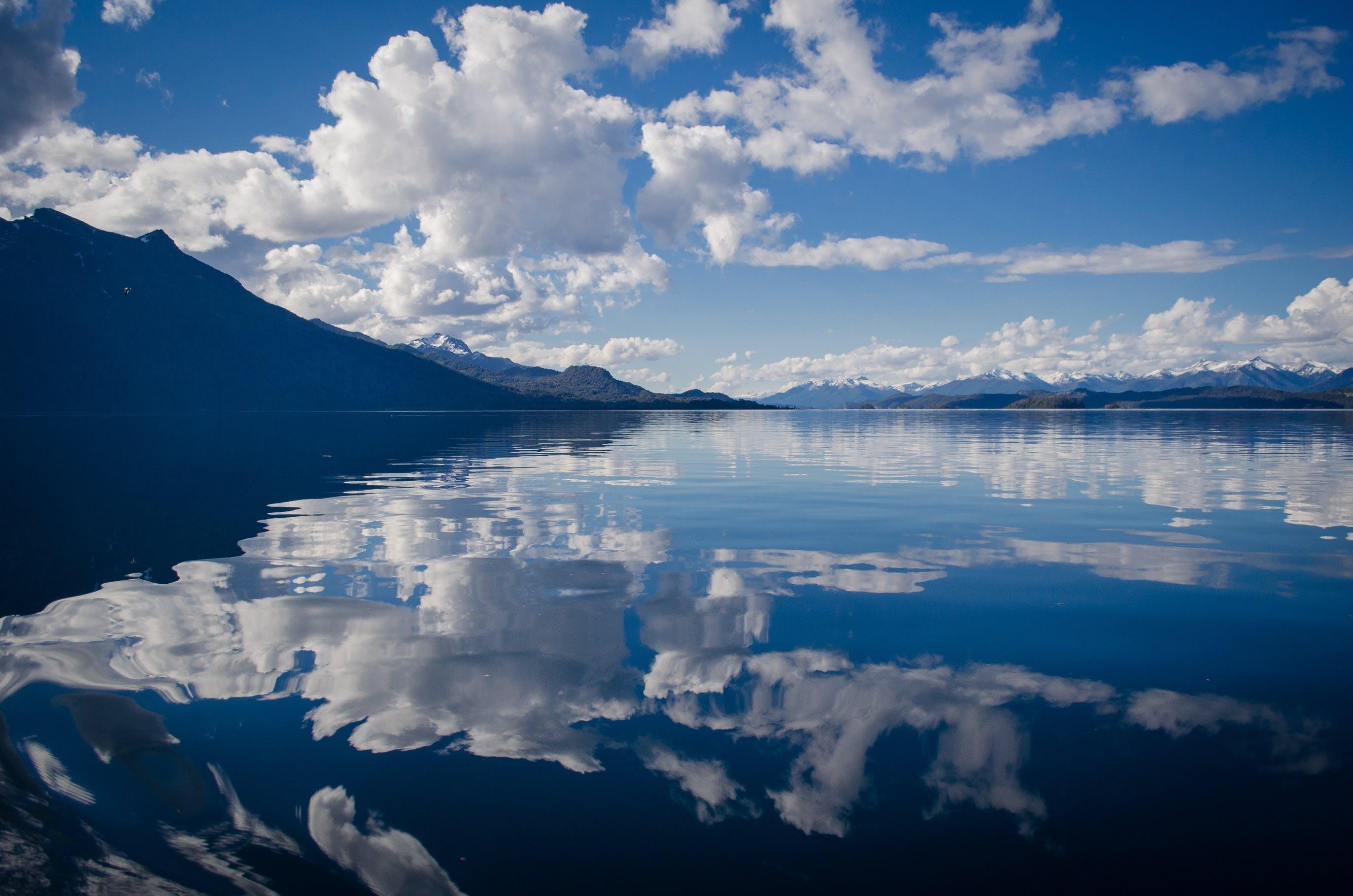 Lake Water Under White and Blue Skies during Daytime