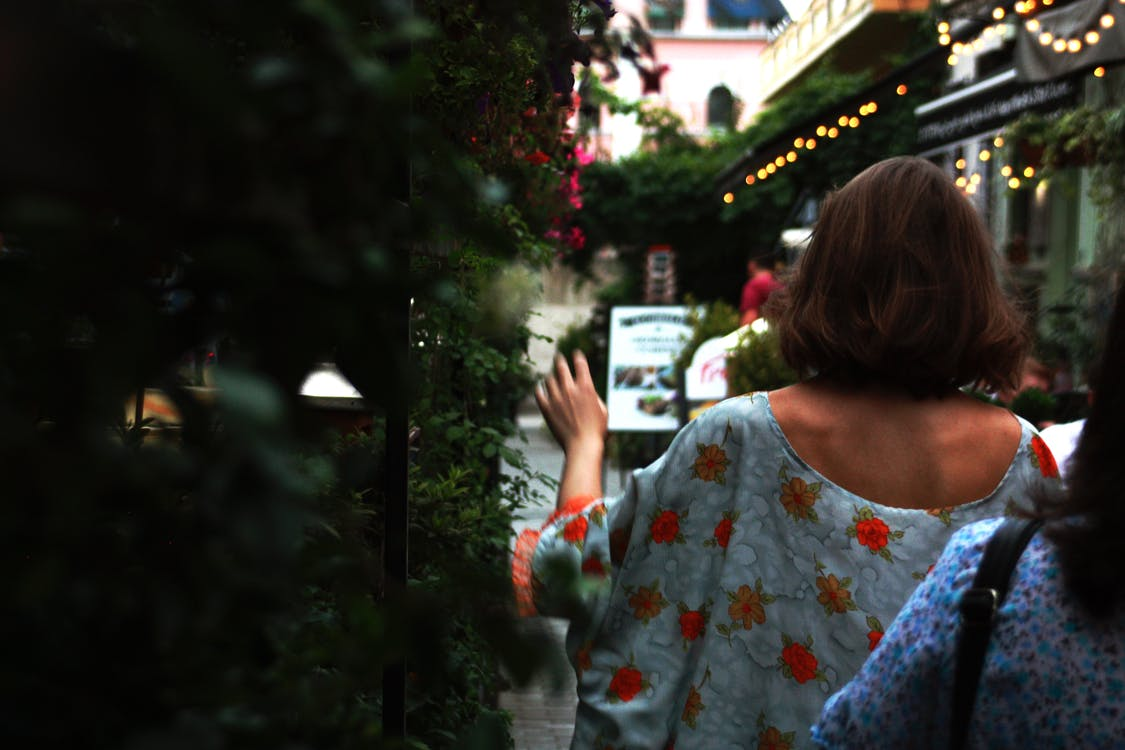 Woman Walking Towards the Street